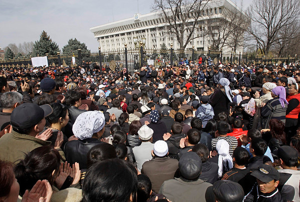 Kyrgyzs gather to mourn revolt victims on central square in Bishkek, Kyrgyzstan, Friday, April 9, 2010. Thousands of grieving and defiant citizens of Kyrgyzstan are gathering in the capital's main square to mourn victims of this week's revolt and forced the president to flee.(AP Photo/Sergei Grits)