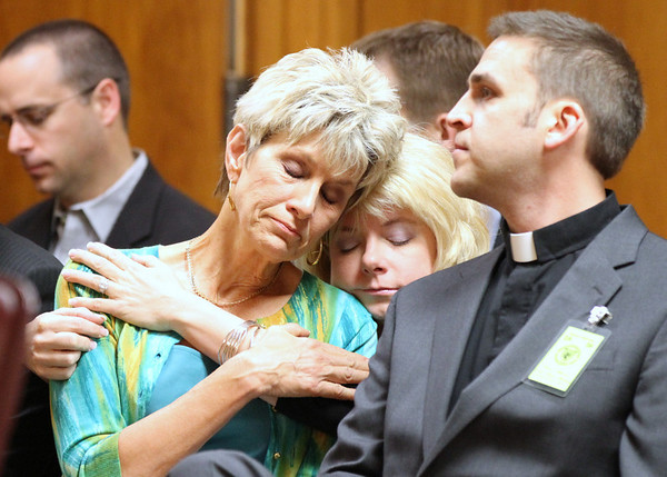 Jeanne Tiller, widow of slain abortion doctor George Tiller, hugs a family member during the sentencing of Scott Roeder in Sedgwick County District Court in Wichita, Kan., Thursday, April 1, 2010. Roeder was convicted last January of murdering Tiller's husband, Dr. George Tiller. (AP Photo/Jeff Tuttle, Pool)