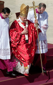 "Pope Benedict XVI is helped by prelates to walk down the steps during Palm Sunday mass in St. Peter's square, at the Vatican, Sunday, March 28, 2010. Pope Benedict XVI opened Holy Week on Sunday amid one of the most serious crises facing the church in decades, with questions about his handling of cases of pedophile priests and the Vatican acknowledging its ""moral credibility'' was on the line. (AP Photo/Gregorio Borgia)"