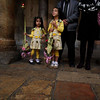 Palestinian Christian girls attend the Palm Sunday mass at the Church of Nativity in the West Bank town of Bethlehem, Sunday, March 28, 2010. Palm Sunday commemorates Jesus Christ's triumphant entry into Jerusalem, and is the start of the Christian Holy Week. (AP Photo/Tara Todras-Whitehill)