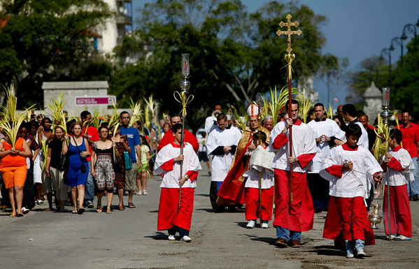 Catholics participate in the Palm Sunday procession in Havana, Sunday, March 28, 2010. Palm Sunday commemorates Jesus Christ's triumphant entry into Jerusalem, and is the start of the Christian Holy Week. (AP Photo/Javier Galeano)