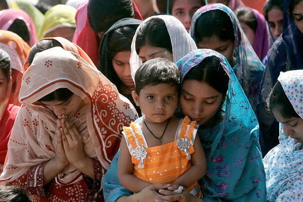 Pakistani Christians take part Sunday service at a church in Lahore, Pakistan on Sunday March 28, 2010. Roman Catholics across  the country observe Palm Sunday to signify the entry of Jesus Christ into Jerusalem and to usher the start of Holy Week. (AP Photo/K.M. Chaudary)