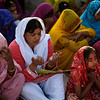 Pakistani Christians pray during a ceremony to celebrate Orthodox Palm Sunday, outside a church in Islamabad, Pakistan, Sunday, March 28, 2010. Palm Sunday commemorates Jesus Christ's triumphant entry into Jerusalem, and is the start of the church's most solemn week. (AP Photo/Muhammed Muheisen)