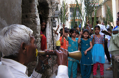 Pakistani Christian children hold palm fronds during blessing rites outside a church in Hyderabad, Pakistan on Sunday March 28, 2010. Roman Catholics across the country observe Palm Sunday to signify the entry of Jesus Christ into Jerusalem and to usher the start of Holy Week. (AP Photo/Pervez Masih)