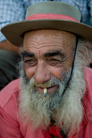 An Uruguayan gaucho, or cowboy, smokes as he attends a rodeo in Montevideo, Sunday, March 28, 2010. Every year, during Holy Week, hundreds of gauchos show their skills and compete for the title of best rider of the rodeo. (AP Photo/Matilde Campodonico)