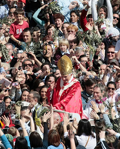 "Pope Benedict XVI is cheered by faithful at the end of Palm Sunday mass in St. Peter's square, at the Vatican, Sunday, March 28, 2010. Pope Benedict XVI opened Holy Week on Sunday amid one of the most serious crises facing the church in decades, with questions about his handling of cases of pedophile priests and the Vatican acknowledging its ""moral credibility'' was on the line. (AP Photo/Gregorio Borgia)"