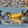 North Metro Fire Rescue District Craig Moilanen, left, rescues firefighter Ed Feeley during ice rescue training at Siena Reservoir at Sheridan Parkway and Lowell Blvd. on Thursday. <br /> January 27, 2013<br /> staff photo/ David R. Jennings<br /> <br /> o