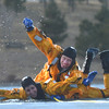 North Metro Fire Rescue District firefighter Josh Deuto signals to shore after rescuing firefighter Craig Moilanen during ice rescue training at Siena Reservoir at Sheridan Parkway and Lowell Blvd. on Thursday. <br /> January 27, 2013<br /> staff photo/ David R. Jennings