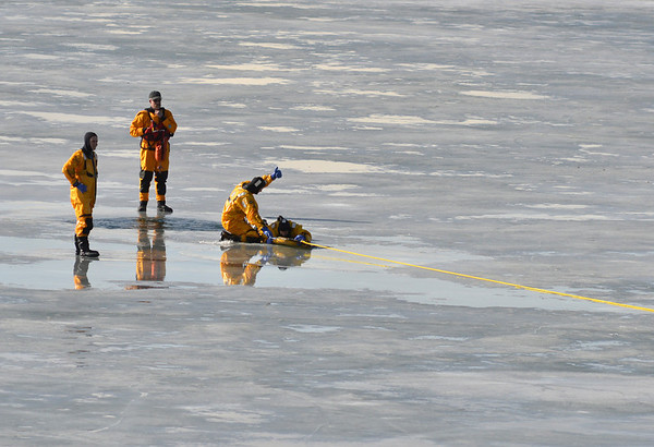 North Metro Fire Rescue District firefighters work on different techniques for ice rescue training at Siena Reservoir at Sheridan Parkway and Lowell Blvd. on Thursday. <br /> January 27, 2013<br /> staff photo/ David R. Jennings