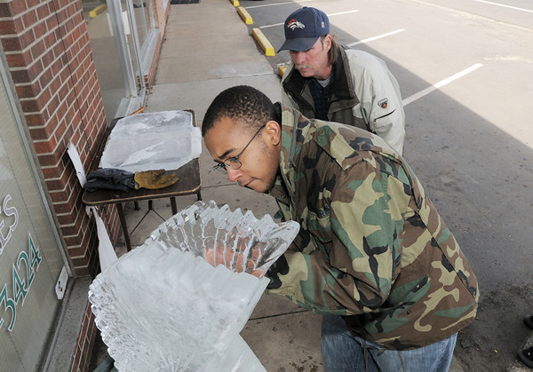 Broomfield High School Pro Start student Theo Robison, 17, works on sculpting the wings of an eagle under the watchful eyes of chef Joel Hanson during the ice sculpting class at Garden Grill Catering on Wednesday.<br /> February 29, 2012 <br /> staff photo/ David R. Jennings