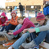 Sydney Richards, 12, left, Zoe Skelton, 13, Alyssa Steed, 12, and Lauren Bade, 12, all from Longmont, put their skates on before going on the ice at the Winter Skate ice rink in the Village at FlatIron Crossing mall on Saturday. <br /> <br /> December 12, 2009<br /> Staff photo/David R. Jennings