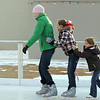 Kerri Dunn, left, leads the line followed by her daughter Katlyn, 11, and cousin Hadley Olsen, 5, as they skate at the Winter Skate ice rink in the Village at FlatIron Crossing mall on Saturday.  <br /> <br /> December 12, 2009<br /> Staff photo/David R. Jennings