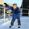 Stephen Arthur, 6, from Las Vegas, holds on to the rial as he skates at the Winter Skate ice rink in the Village at FlatIron Crossing mall on Saturday. <br /> <br /> December 12, 2009<br /> Staff photo/David R. Jennings