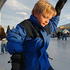 Stephen Arthur, 6, from Las Vegas, holds on to the rail as he skates at the Winter Skate ice rink in the Village at FlatIron Crossing mall on Saturday. <br /> <br /> <br /> December 12, 2009<br /> Staff photo/David R. Jennings