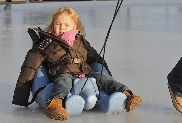 Samantha Olsen, 3, from Broomfield, rides a sled pulled by her mother Marce at the Winter Skate ice rink in the Village at FlatIron Crossing mall on Saturday. <br /> <br /> December 12, 2009<br /> Staff photo/David R. Jennings