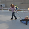 Marce Olsen, left, pulls her daughter Samantha, 3, on a sled at the Winter Skate ice rink in the Village at FlatIron Crossing mall on Saturday.  The Olsen's are from Broomfield.<br /> <br /> December 12, 2009<br /> Staff photo/David R. Jennings