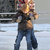 Katlyn Dunn, 11, back, holds her cousin Hadley Olsen, 5, as they skate at the Winter Skate ice rink in the Village at FlatIron Crossing mall on Saturday. <br /> <br /> December 12, 2009<br /> Staff photo/David R. Jennings
