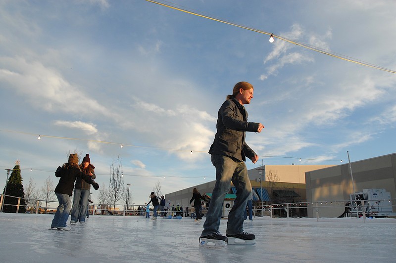 Michael Boughton, right, from Superior,  skates with friends from Las Vegas at the Winter Skate ice rink in the Village at FlatIron Crossing mall on Saturday. <br /> <br /> December 12, 2009<br /> Staff photo/David R. Jennings