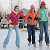 Alyssa Steed, 12, left, with Zoe Skelton, 13, and Lauren Bade, 12, from Longmont, hold on to each other as they skate at the Winter Skate ice rink in the Village at FlatIron Crossing mall on Saturday. <br /> <br /> December 12, 2009<br /> Staff photo/David R. Jennings