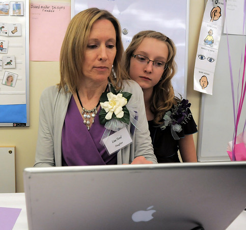"Lisa Ford, left, with her daughter Breanna, 11, daughter and grand daughter of Marlene Politzer , post ""Marlene-isms""  during the Bal Swan Children's Center open house in celebration of the life of Marlene Politzer the director emeritus on Saturday.<br /> April 9, 2011<br /> staff photo/David R. Jennings"