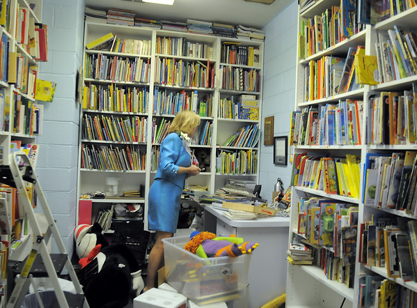 Cathlynn Simonak, one of Marlene Politzer 's daughters, looks around Marlene's original office before the Bal Swan Children's Center open house celebration of the life of Marlene Politzer the director emeritus on Saturday.<br /> April 9, 2011<br /> staff photo/David R. Jennings