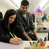 Lindsey Willardson, left and her brother Nic make a card in memory of Marlene Politzer during the Bal Swan Children's Center open house celebration of the life of Politzer on Saturday.<br /> April 9, 2011<br /> staff photo/David R. Jennings