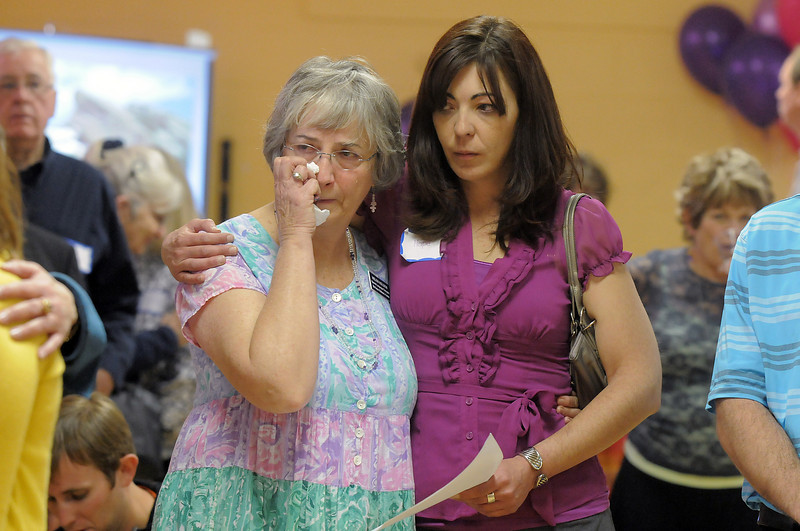 Helen Holden, left, a teacher at Bal Swan, and former teacher Hope Billsbailey hold each other while songs honoring Marlene Politzer are sung during the Bal Swan Children's Center open house celebration of the life of Marlene Politzer the director emeritus on Saturday.<br /> April 9, 2011<br /> staff photo/David R. Jennings