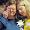 Laurie Putnam, left, daughter of Marlene Politzer weeps with Politzer's grand daughter-in-law Ashley Simonak while Amazing Grace is sung during the Bal Swan Children's Center open house celebration of the life of Politzer on Saturday. Politzer died on Tuesday April 5th.<br /> April 9, 2011<br /> staff photo/David R. Jennings