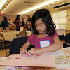 Daanya Hoda, 5, makes a card in memory of Marlene Politzer during Bal Swan Children's Center open house in celebration of the life of Politzer, director emeritus, on Saturday. <br /> April 9, 2011<br /> staff photo/David R. Jennings