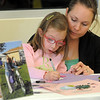 Riley Tuttle, 6, left, an alumnus of Bal Swan, with her mother Tami, makes a card in memory of Marlene Politzer during the Bal Swan Children's Center open house celebration of the life of Marlene Politzer on Saturday.<br /> April 9, 2011<br /> staff photo/David R. Jennings