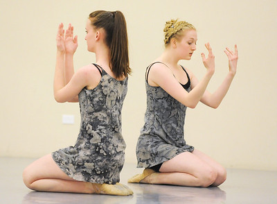 Kerry Healy, left, and Sarah Jannsen perform a dance for the Ballet Nouveau Colorado student company's production of In The Along at the studio.  May 04, 2012  staff photo/ David R. Jennings