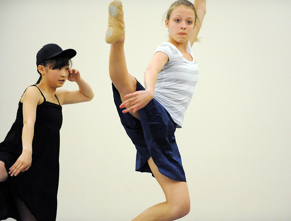 Brooke Gilliam, right, and Momo Sakai perform a dance for the Ballet Nouveau Colorado student company's production of In The Along at the studio.<br /> <br /> May 04, 2012 <br /> staff photo/ David R. Jennings