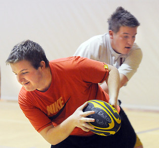 Luke Stanley, 19, left, is tackled by Jake Grossman, 16, during practice with the Tigers Rugby Football Club at the Paul Derda Recreation Center on Saturday.   January 02, 2009 Staff photo/David R. Jennings