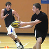 Kyle VanDerveen, 18, right, passes the ball to Zach Underwood 17, during practice with the Tigers Rugby Football Club at the Paul Derda Recreation Center on Saturday. Players from Holy Family , Pomona, Standley Lake,   Broomfield and other northwest area schools and adults practiced in the gym.<br /> <br /> January 02, 2009<br /> Staff photo/David R. Jennings