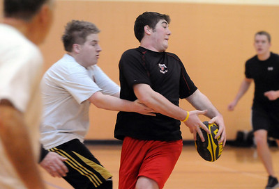 Jake Gossman, 16, left, tackles Donny Haupt, 18, while passing the ball during practice with the Tigers Rugby Football Club at the Paul Derda Recreation Center on Saturday. Players from Holy Family , Pomona, Standley Lake,   Broomfield and other northwest area schools and adults practiced in the gym.  January 02, 2009 Staff photo/David R. Jennings