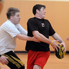 Jake Gossman, 16, left, tackles Donny Haupt, 18, while passing the ball during practice with the Tigers Rugby Football Club at the Paul Derda Recreation Center on Saturday. Players from Holy Family , Pomona, Standley Lake,   Broomfield and other northwest area schools and adults practiced in the gym.<br /> <br /> January 02, 2009<br /> Staff photo/David R. Jennings