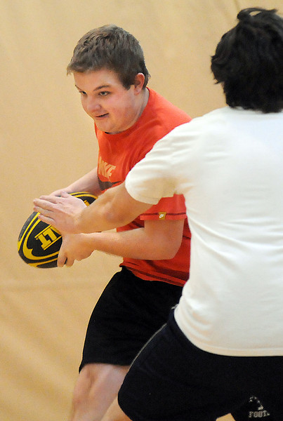 Luke Stanley, 19, left, runs around Daniel Sargeant. 17. during practice with the Tigers Rugby Football Club at the Paul Derda Recreation Center on Saturday. Players from Holy Family , Pomona, Standley Lake,   Broomfield and other northwest area schools and adults practiced in the gym.<br /> <br /> January 02, 2009<br /> Staff photo/David R. Jennings