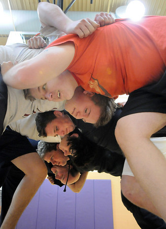 Players and coaches form a scrum during practice with the Tigers Rugby Football Club at the Paul Derda Recreation Center on Saturday. The national headquarters for USA rugby is based in Boulder.<br /> January 02, 2009<br /> Staff photo/David R. Jennings
