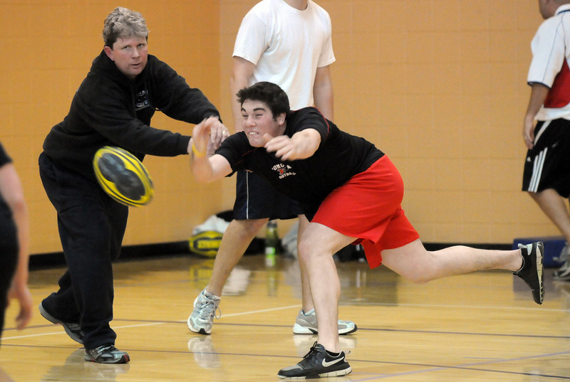 Donny Haupt, 18, right, passes the ball away from head coach Paul O'Brian during practice with the Tigers Rugby Football Club at the Paul Derda Recreation Center on Saturday. Players from Holy Family, Pomona, Standley Lake, Broomfield and other northwest area schools and adults practiced in the gym.<br /> <br /> January 02, 2009<br /> Staff photo/David R. Jennings