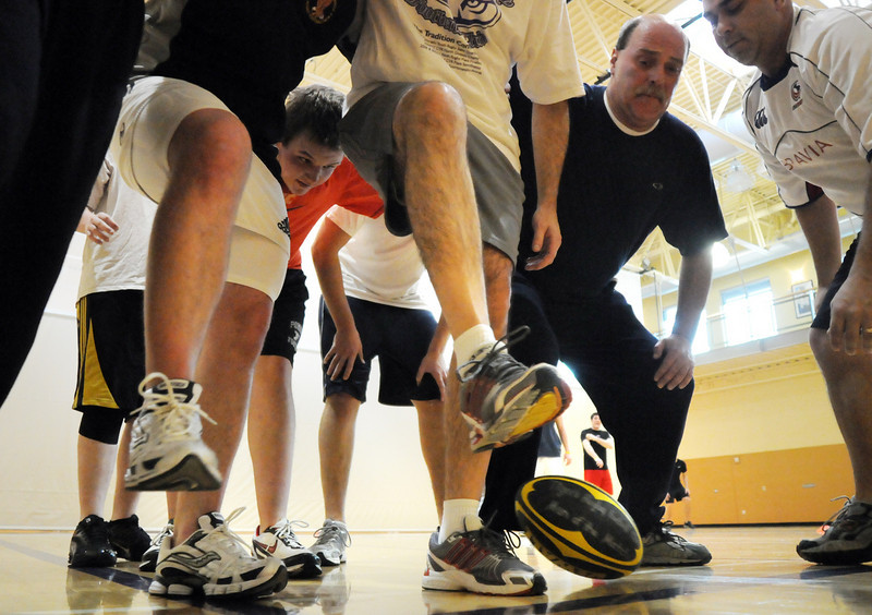 The team forms a tunnel in a scrum kicking the ball to the back of the scrum during practice with the Tigers Rugby Football Club at the Paul Derda Recreation Center on Saturday. <br /> <br /> January 02, 2009<br /> Staff photo/David R. Jennings