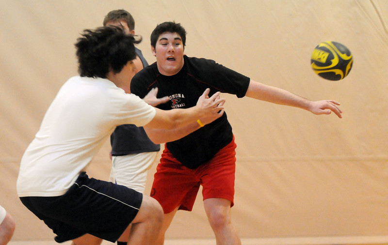 Donny Haupt, 18, right, passes the ball away from Daniel Sargeant, 17, during practice with the Tigers Rugby Football Club at the Paul Derda Recreation Center on Saturday. <br /> <br /> January 02, 2009<br /> Staff photo/David R. Jennings