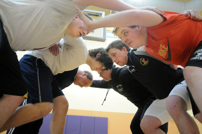 Players and coaches form a scrum during practice with the Tigers Rugby Football Club at the Paul Derda Recreation Center on Saturday.<br /> <br /> January 02, 2009<br /> Staff photo/David R. Jennings