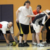 Assistant coach Nick Samaras, left, picks up the ball from a scrum formation during practice with the Tigers Rugby Football Club at the Paul Derda Recreation Center on Saturday. Players from Holy Family , Pomona, Standley Lake,   Broomfield and other northwest area schools and adults practiced in the gym.<br /> <br /> January 02, 2009<br /> Staff photo/David R. Jennings