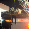 North Metro Fire Rescue paramedic Matt Gintzler rides with an injured worker for a technical rescue off of the roof of the Diamond Shamrock Station at 10th and US 287 on Wednsday evening. <br /> December 22, 2010<br /> staff photo/David R. Jennings