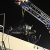 Firefighters guide North Metro Fire Rescue paramedic Matt Gintzler rides with an injured worker during a technical rescue off of the roof of the Diamond Shamrock Station at 10th and US 287 on Wednsday evening. <br /> December 22, 2010<br /> staff photo/David R. Jennings