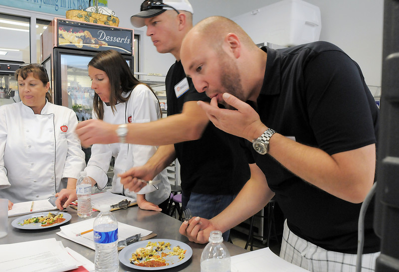 Chef judges Sarah Acker, left, and Brandy  Dreibelis with SALT Bistro chef Bradford Heap and Jax Fish House chef/owner Hosea Rosenberg taste food made by student teams during the Iron Chefs competition by the  Boulder Valley School District-School Food Project at Broomfield High on Wednesday.<br /> May 4, 2011<br /> staff photo/David R. Jennings