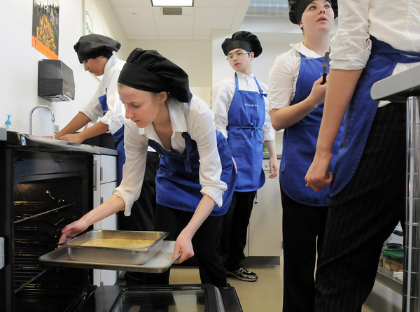 Kelsey Ladtkow places the casserole into the oven for her team Broomfield High Catering during the Iron Chefs competition by the  Boulder Valley School District-School Food Project at Broomfield High on Wednesday.<br /> May 4, 2011<br /> staff photo/David R. Jennings