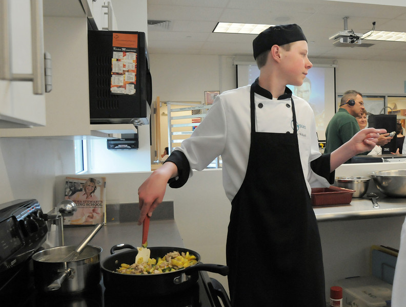 Broomfield High ProStart team member Adam Wolinski at the stove preparing ingredients for their casserole during the Iron Chefs competition by the  Boulder Valley School District-School Food Project at Broomfield High on Wednesday.<br /> May 4, 2011<br /> staff photo/David R. Jennings