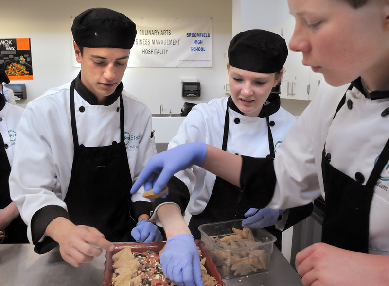 Broomfield High ProStart team members Isaac Wilson, left, Abby Carlson and Adam Wolinski place hand made pita bread to top off their casserole during the Iron Chefs competition by the  Boulder Valley School District-School Food Project at Broomfield High on Wednesday.<br /> May 4, 2011<br /> staff photo/David R. Jennings