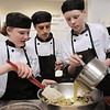 Broomfield High ProStart team members Abby Carlson, left, Isaac Wilson and Adam Wolinski add sauce to their casserole during the Iron Chefs competition by the  Boulder Valley School District-School Food Project at Broomfield High on Wednesday.<br /> May 4, 2011<br /> staff photo/David R. Jennings